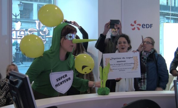 "Meanwhile, Sortir du Nucleaire went to a nearby Electricite de France office to present the world's largest nuclear utility with a ""Super Liar"" for its efforts to portray nuclear power as a climate solution. Video available at: http://www.sortirdunucleaire.org/EDF-super-menteur"